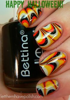 I'm not into nail art but if I was, these are definitely inspirational -- but in different color scheme
