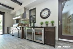 """A fully equipped kitchen in the four-season room is the site of many family gatherings.     See more of this home in """"Floating Fireplace First of Its Kind in Windsor Area"""" from OUR HOMES Windsor Summer 2016  http://www.ourhomes.ca/articles/build/article/floating-fireplace-first-of-its-kind-in-windsor-area"""