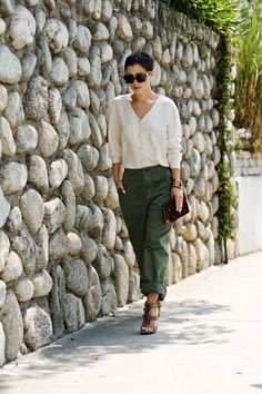 i'm so digging the green pants trend - bought a pair of kelly green silk pants today!!!  much brighter than this color but will totally pull off this look.