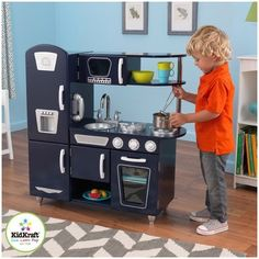 KidKraft Navy Vintage Play Kitchen - 53296 - Order's up! The KidKraft Navy Vintage Play Kitchen - 53296 is here to serve your child's imagination. This delightful set comes complete with fridge,. Play Kitchen Sets, Toy Kitchen, Play Kitchens, Cocina Kidkraft, Kidkraft Vintage Kitchen, Childrens Kitchens, Tv Entertainment Units, Floor Puzzle, Estilo Retro