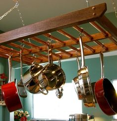DIY: turn an old ladder into a pot rack (This looks like a bunk bed ladder to me). #LiquidGoldSalvagedWood
