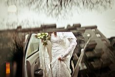 stunning wedding photo of bride getting into car by top wedding photographer Daniele Del Castillo   via junebugweddings.com