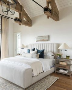 This gray and white bedroom strikes a nice balance between chic and rustic style with ceiling beams and lantern lighting. For minimalist bedroom looks, check out these other gray and white bedrooms.