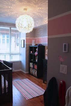 Pink and grey nursery full of chic goodness. Love the light fixture/pattern it gives to the ceiling. A girl room, too cute. Nursery Room, Kids Bedroom, Baby Room, Nursery Ideas, Master Bedroom, Room Ideas, Nursery Themes, Pink And Gray Nursery, Striped Nursery