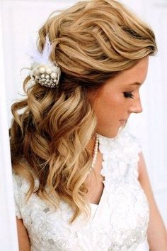 A beautiful hair colour can be shown in all it's glory with this half-up, half-down hairstyle that is tastefully gathered to the back and embellished with a detailed headpiece.