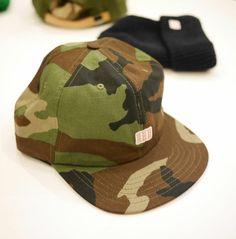 Topo hats made in Colarado USA. Shop online at store.aquirkoffate.com/topo-designs