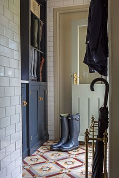 Amazing patterned tiles and beautiful fitted Classic English furniture in this stylish boot room by deVOL. Interior Designer: Imraan Ismail Interiors Photograoher Daniella Cesarei