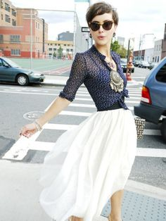 flowy skirt, printed top, and giant accesories