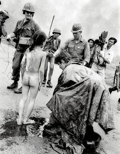 June 8, 1972 ,Highway 1, Vietnam. Journalist Christopher Wain  tries to help Phan Thj Kim Phuc | AP / Nick Ut