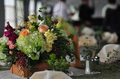 Earthy flower arrangments for reception