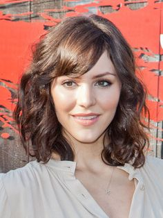 Cosmo: Hairstyles With Bangs- (Getty Images) Swooping If you want to try bangs with curly hair, take a cue from Katharine McPhee. This swept-to-the-side style works well.