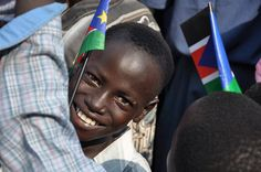 A young south Sudanese boy celebrates independence. (UNDP photo)