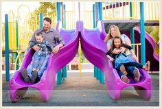 Family photo on the slides at the park playground