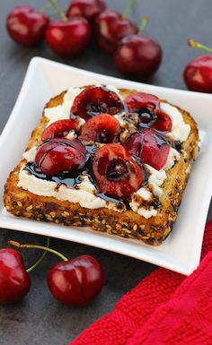 Balsamic Cherries & Ricotta Toast: Celebrate cherry season with this umami-full toast. eureka! Top Seed Organic Bread is extra decadent with a generous schmear of creamy ricotta, halved sweet cherries and a drizzle of tangy balsamic glaze.