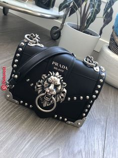 38b84878f98a Prada cahier lion head black and silver