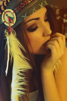 Pretty Boho/hippie girl with Native American/Indian headwrap (feathers) with smokey eye and glowing skin