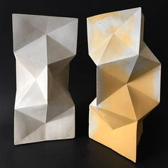 WONDERFUL FACETED CONCRETE VASE INSPIRED IN ORIGAMI GEOMETRIC PATTERNS. HAND POURED AND CAST IN OUR STUDIO IN TORONTO CANADA, THIS SCULPTURAL PIECE ISONE OF A KIND. A DESIGN ELEMENT THAT WOULD LOOK AMAZING IN ANY SPACE. DIMENSIONS: H: 21.0CM X 11.0 CM BECAUSE THE NATURE OF CONCRETE,