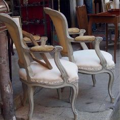 Adore these chairs w/ their gray wash & bare burlap upholstered backs. Perfectly combines old & new, refinished & deconstructed. | #parisfleamarketstyle #frenchchairs #deconstructedchairs