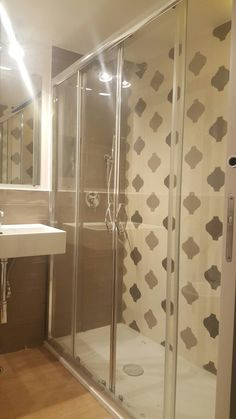 Master_Bath in Naples_Casa Fabrizio. Arabesque by Tonalite tiles and wood floor Extra Large Shower Stall