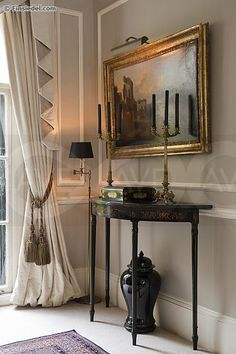 """A lovely corner:  cotton damask curtains by Ian Sanderson, a pair of ormolu candelabra, an 18th C. console, Farrow and Ball """"Stony Gray"""" wall color"""