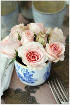 blue and white cup with pink roses...LOVE the soft pink with blue and white!