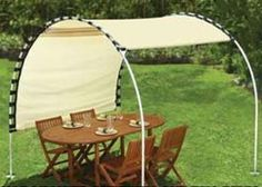 creative DIY way to shade an outdoor spot, so doable! would be great for a country themed event...stagecoach :)