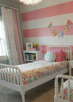 a little of this, a little of that: Girls Room {Tour}. I like the pale blue walls with the pink striped accent wall, and the ruffle curtains. . .