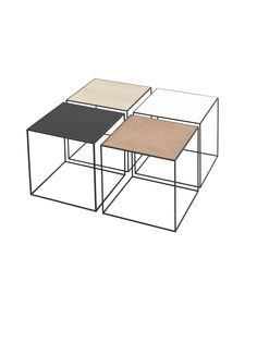 Mogens Lassen's preferred form was the square and stringent shape of the cube, and it is the source of the small table Twin. With its flexible top, which features a different surface on each side, Twin offers the potential for a variety of design expressions in one and the same table. The tabletop is placed on a cube-shaped frame made of 6 mm thin steel profiles, which lend the table a very light and stringent appearance.  In his spirit, by Lassen has created the unique table known as Twin.