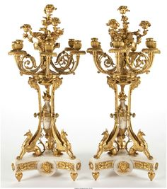 PAIR OF NAPOLEON III TEN-LIGHT GILT BRONZE AND MARBLE FIGURAL CANDELABRA France, circa 1875 34-1/2 inches high (87.6 cm) (each).