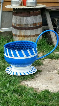 Tea cup planter made out of quad tire and rim, cut the side wall for the saucer and plastic tubing for the handle and spray painted it all!