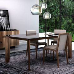 """The Magnolia Dining Table featurs a lacquered glass table top which rests on natural walnut legs. The legs are cut at an angle and angled inward, toward the center of the dining table, which adds visual interest and help set the stage for an exceptional dining experience. Table comes in two sizes: - 60""""W X 36""""D X 30""""H - 76""""W X 40""""D X 30""""H Please allow 7-10 weeks for shipping."""