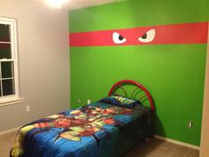 Teenage mutant ninja turtle room! I don't know if Jake will ever be into TMNT or not but he might. I already have some vintage TMNT sheets and pillow cases I found a thrift store. all I would need is a blanket. I would also use the green paint from the wall and paint his chest of drawers green and paint the different bandana colors and eyes across the drawers . Would be a cute room