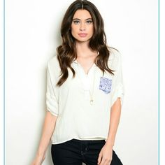 White button down w/ pop of color pocket COMING 3.28! White button down shirt with collar, loose fitting and flowy, with a colorful blue pocket to add a pop of color. 22 L. Sizes S, M available.  100% rayon. STOCK PHOTO USED WITH DIRECT PERMISSION FROM SUPPLIER. Tops