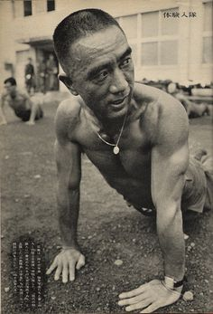 Mishima Yukio ~ ...performing push ups at his military duty..