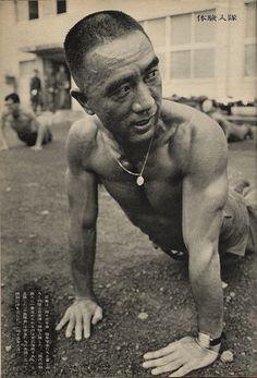 Mishima Yukio ~ ...performing push ups at his military duty..