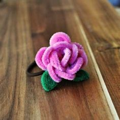Learn how to make this pipe cleaner rose hair tie.