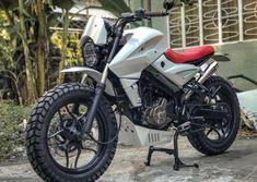 Bajaj Pulsar modified into a gorgeous scrambler Bajaj Motos, Scrambler Motorcycle, Motorcycle News, Motorcycles, Ns 200, Dual Clutch Transmission, Custom Cafe Racer, Suzuki Gsx, Custom Motorcycles