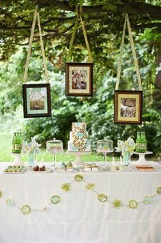 love the bunting in swoops on the table and I love the framed photos hanging outside...maybe behind the dance floor on the patio with initials, hearts, photos, scrapbook stuff in frames?