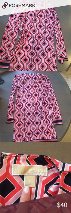 MICHAEL Michael Kors dress Hardly worn MICHAEL Michael Kors dress is size small. Fun print, stretchy material. Zipped in the back. Color is pink, orange and blue MICHAEL Michael Kors Dresses Midi