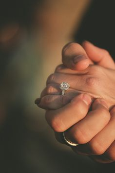 shot of the bride and grooms hands during their first dance*