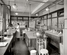 Mrs. M.M. Brooke, a chemist in her laboratory at the Corby Baking Company, c. 1922