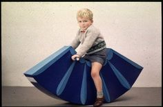 Prototype sit-on rocking toy made from blue painted cardboard.   Design: Graham Wainwright - Leeds College of Art, 1968.  Credit: Design Council Slide Collection. Vads.