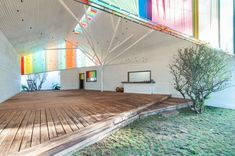 """a21studio's Rainbow Chapel: This rainbow chapel and community center, on the outskirts of Ho Chi Minh City, gives life to a region lacking in community centers for people to host conferences, weddings and exhibitions. The multicolored wonder was named World Architecture Festival (WAF)'s """"building of the year"""" in 2014."""