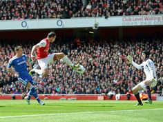 Van Persie was presented with a great chance as a Walcott free-kick found the striker free at the backpost. However he mishit and struck the post.