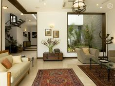 Living Room with rugs designed by Kumar Moorthy Associates. - Feste Home Decor indian home decor Living Room with rugs designed by Kumar Moorthy Associates