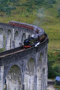 Jacobite train  Hogwart's Express going over the Glenfinnan Viaduct in Scotland