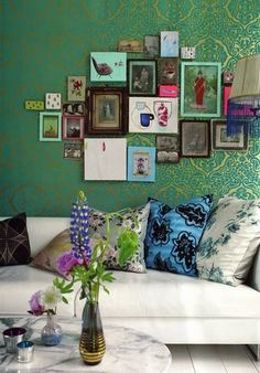 I love when pictures are grouped this way. the different frames and sizes are wonderful. Also loving the colour of this wall!