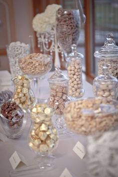 a candy bar is a great idea for any wedding because every guest can choose sweets