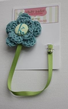 Crochet Flower Pacifier Clip. Adorable! I want one :)