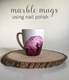 These beautiful DIY Marble Mugs are perfect as personalized gifts or for your own home. And they're as easy to make as they are gorgeous. All you need for this nail polish mug hack are the following supplies: disposable container, nail polish, wood coffee stirrer or toothpick, mug, sponge brush, and glossy acrylic sealer. #diymug #nailpolishhacks